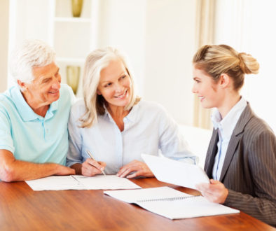 Financial Advisor Discussing With Senior Couple